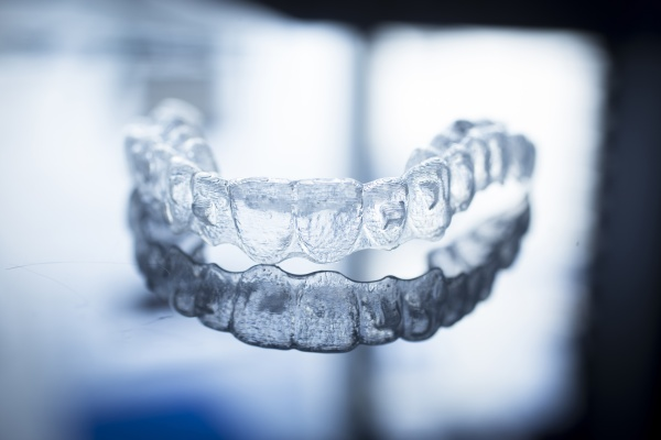 How Can Treatment From An Invisalign® Dentist Help?